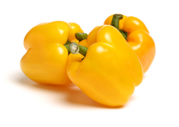fresh bell pepper (capsicum) on white background fresh bell pepper (capsicum) on white background yellow bell pepper stock pictures, royalty-free photos & images