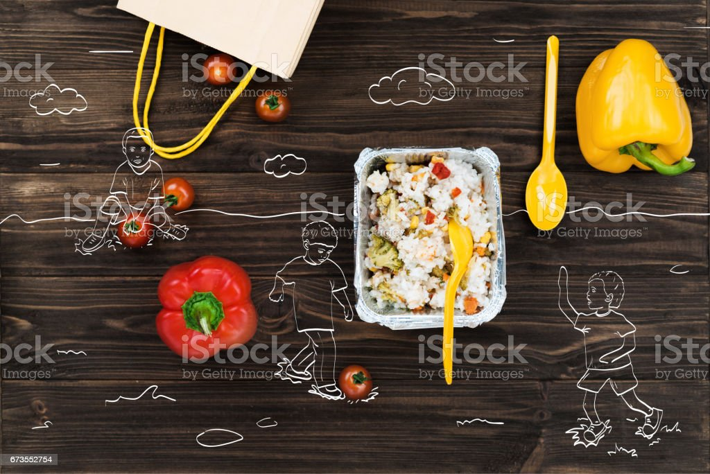 Fresh bell peppers lying near cooked rice royalty-free stock photo