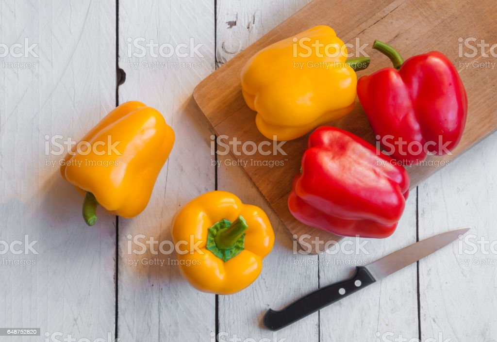 Fresh bell peppers on cutting board stock photo