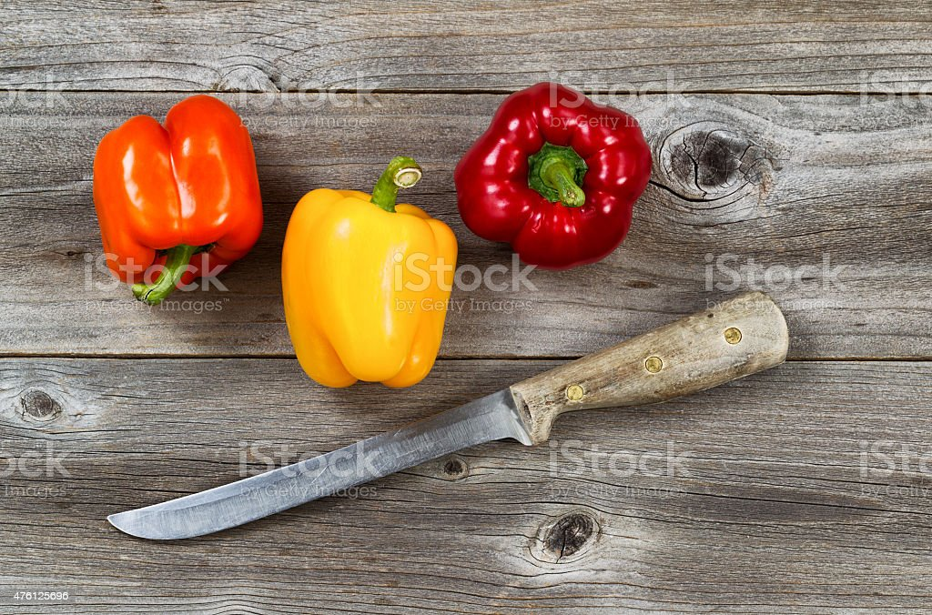 Fresh bell peppers ready to clean stock photo