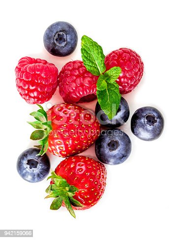 942159066 istock photo Fresh berries isolated on white background, top view. Strawberry, Raspberry, Blueberry and Mint leaf, flat lay