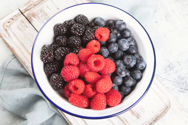 Fresh berries mix in bowl stock photo