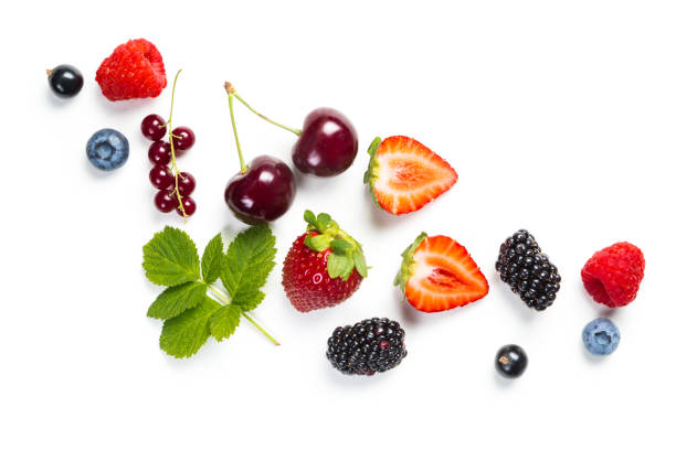 fresh berries on white background - berry stock photos and pictures