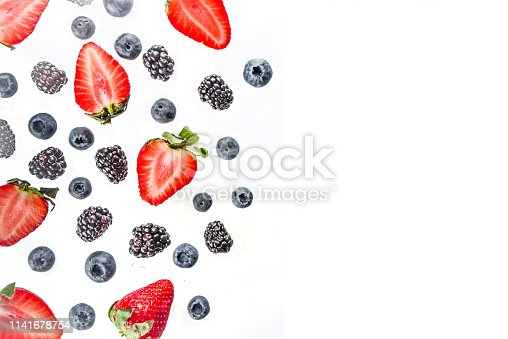 942159066 istock photo Fresh berries pattern - blueberries, strawberries, blackberries 1141678754