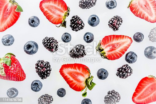 942159066 istock photo Fresh berries pattern - blueberries, strawberries, blackberries 1141678756