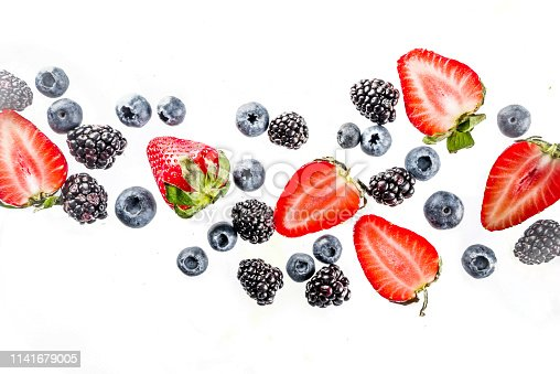942159066 istock photo Fresh berries pattern - blueberries, strawberries, blackberries 1141679005