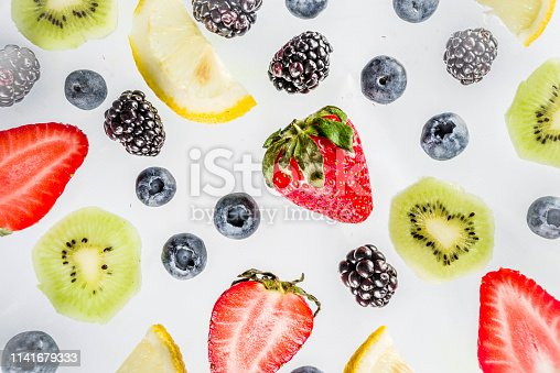 942159066 istock photo Fresh berries pattern - blueberries, strawberries, blackberries 1141679333