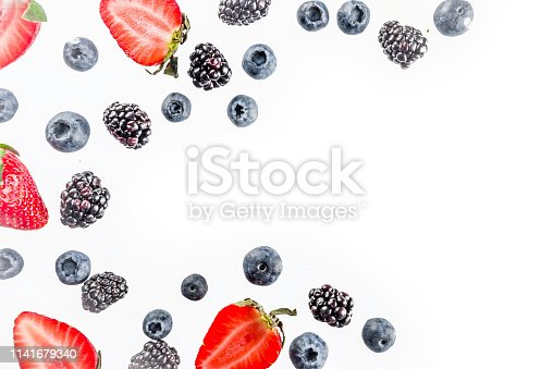 942159066 istock photo Fresh berries pattern - blueberries, strawberries, blackberries 1141679340