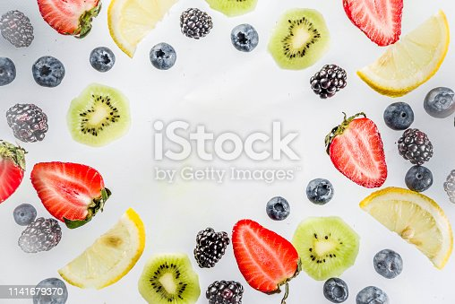 942159066 istock photo Fresh berries pattern - blueberries, strawberries, blackberries 1141679370