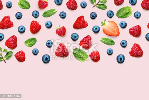 istock Fresh berry and fruit mix border frame banner of ripe berries and mint leaves on pink background. Flat lay. Fruit pattern 1215567167