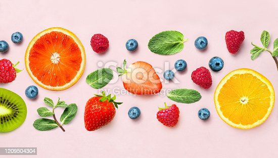 istock Fresh berry and fruit mix border frame banner of various ripe berries and mint leaves on pink background. Flat lay. Fruit pattern 1209504304