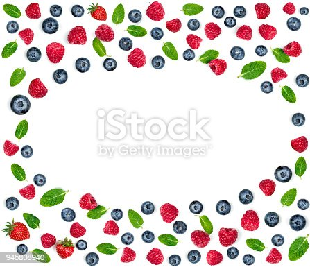879258868 istock photo Fresh Berry mix pattern. Fresh  raspberries and blueberries with leaves isolated on white background. Berry ornament 945808940