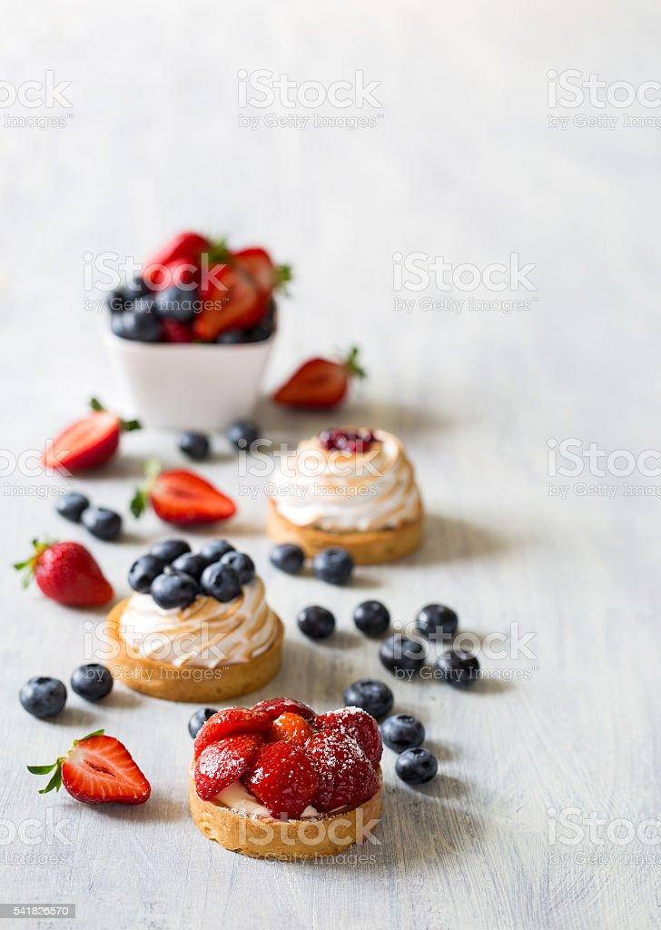 Fresh berry tarts with strawberry and blueberry stock photo