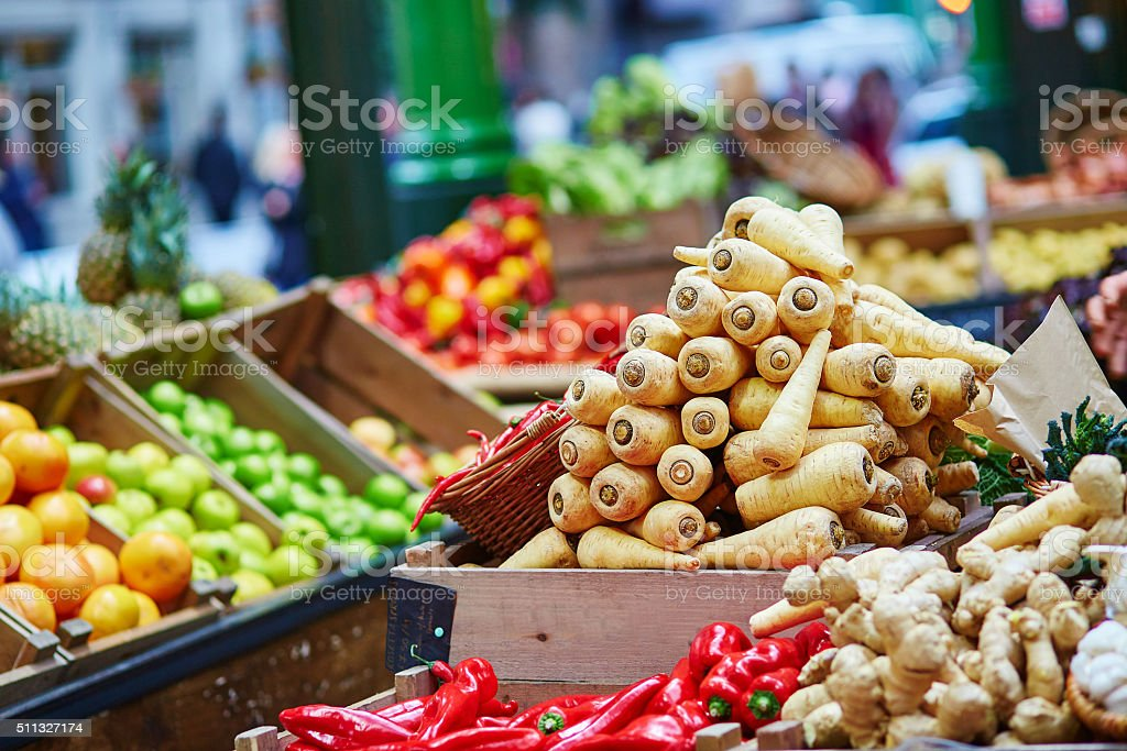 Fresh  bio parsnip on London farmer market Fresh healthy bio parsnip on London farmer agricultural market Basket Stock Photo