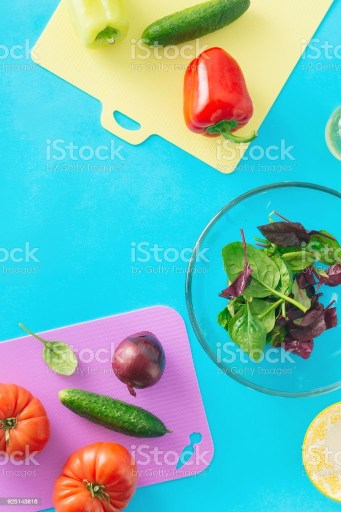 Fresh biodynamic ingredients for cooking summer salad on blue background, top view. Flat lay. Healthy food background - foto stock