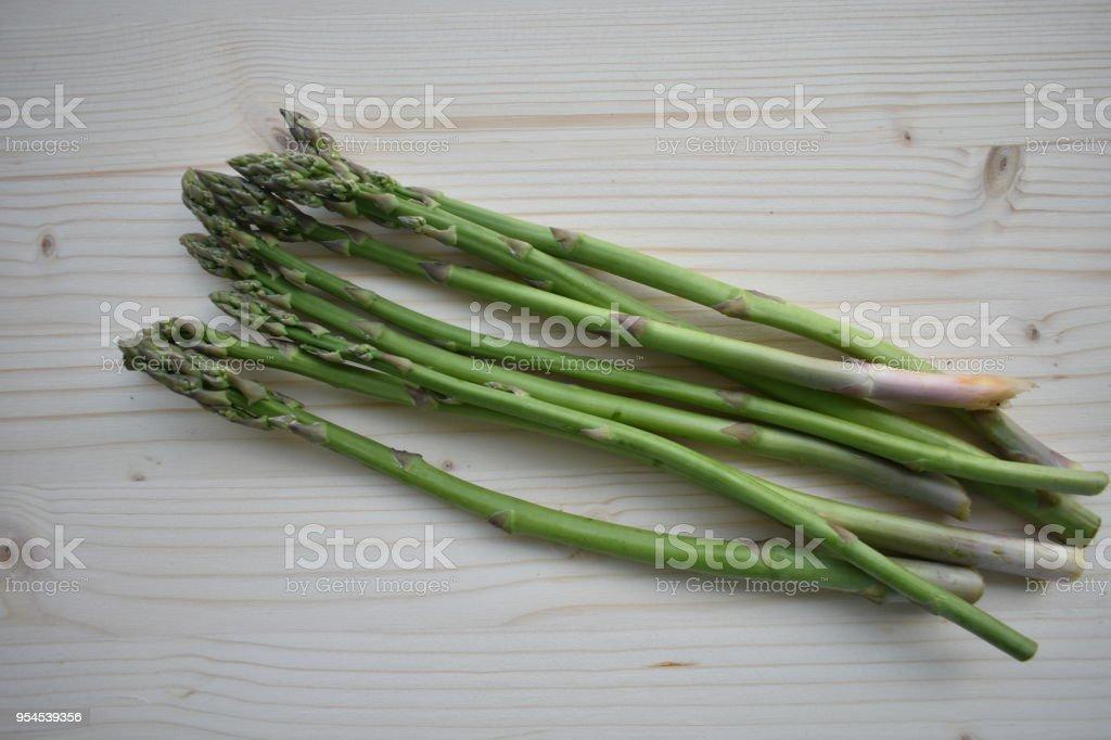 Fresh Biologic Asparagus on Wooden Background stock photo