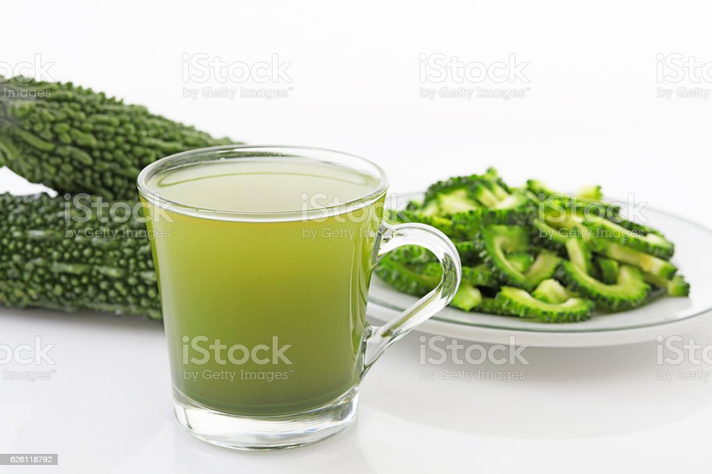 Fresh bitter gourd and juice stock photo
