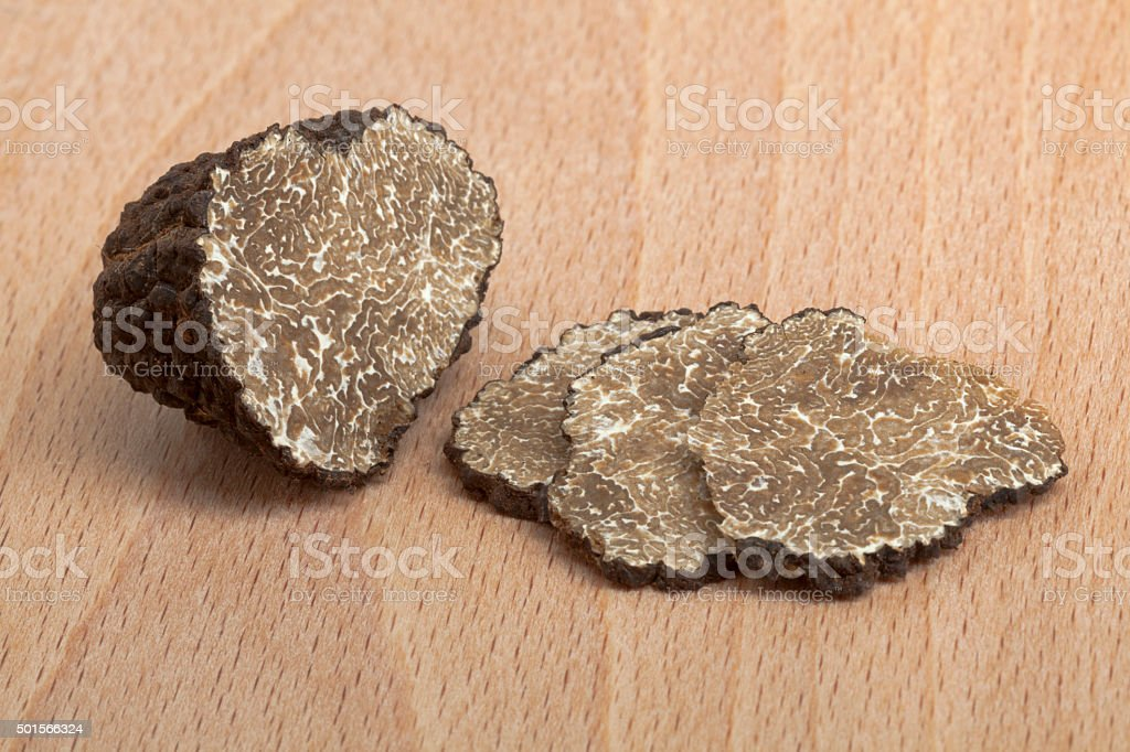 Fresh black truffle and slices stock photo