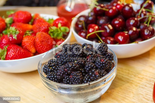 Fresh Blackberries Strawberries and Cherries un still life with out of focus background