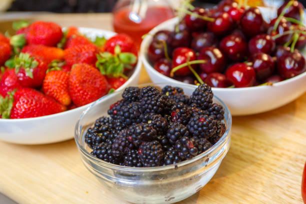 Fresh Blackberries Strawberries and Cherries stock photo