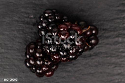 istock Fresh blackberry on grey stone 1180105505