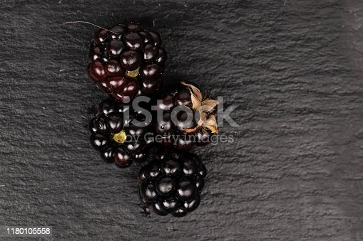 istock Fresh blackberry on grey stone 1180105558