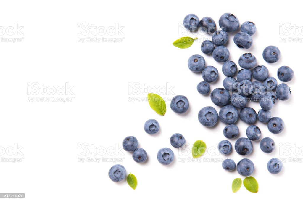 Fresh blueberries and leaves, berry frame isolated on white background, top view stock photo