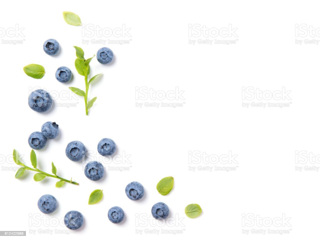 Fresh blueberries and leaves, berry ornament frame on white background, closeup, top view stock photo