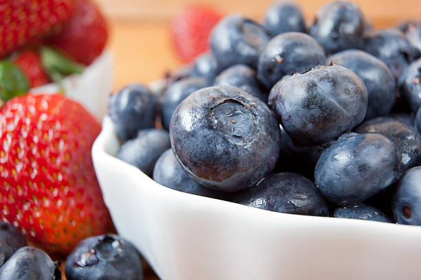Fresh Blueberries and Strawberries stock photo