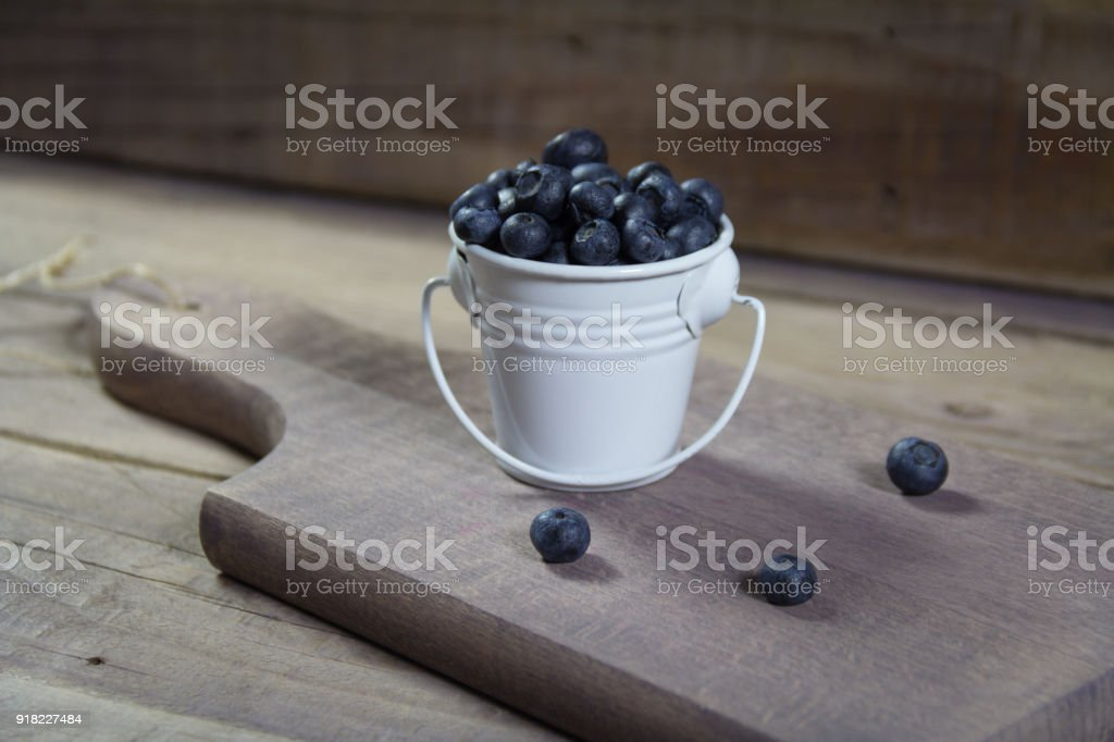 Fresh blueberries in a can stock photo