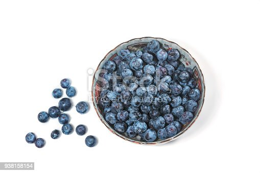 828761410 istock photo Fresh blueberries in bowl isolated on white background, copy space 938158154