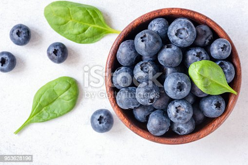 670420880istockphoto Fresh blueberries in bowl on white background, top view 953628196