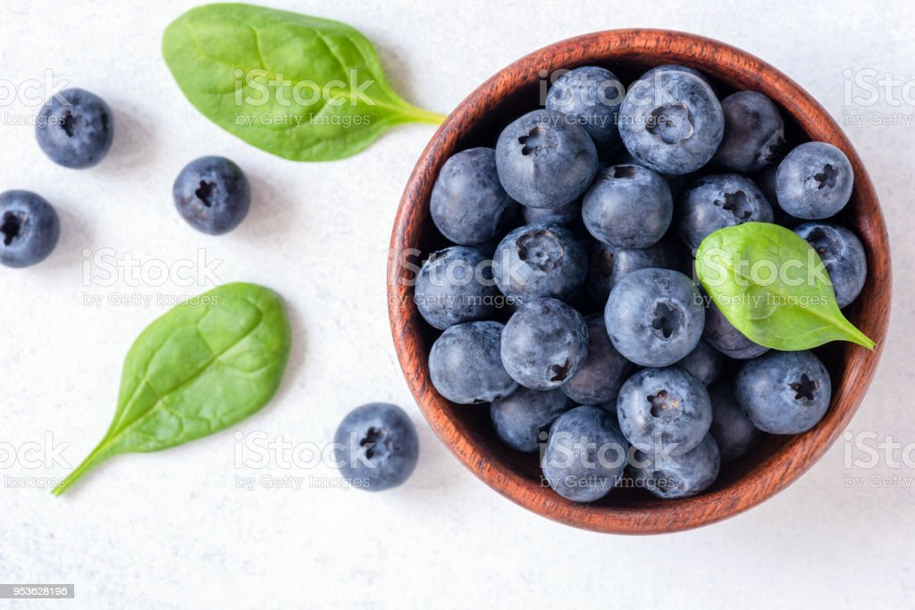 Fresh blueberries in bowl on white background, top view stock photo