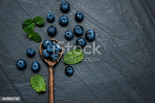 Fresh blueberries on a black  stone background