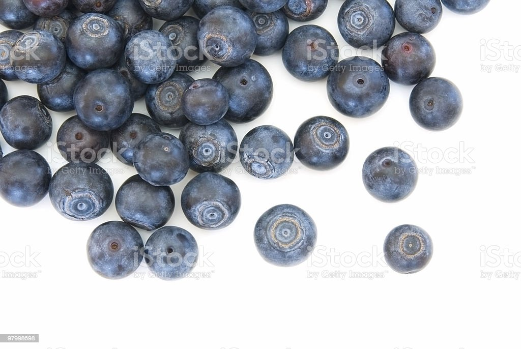 Fresh blueberries spilled on white royalty-free stock photo