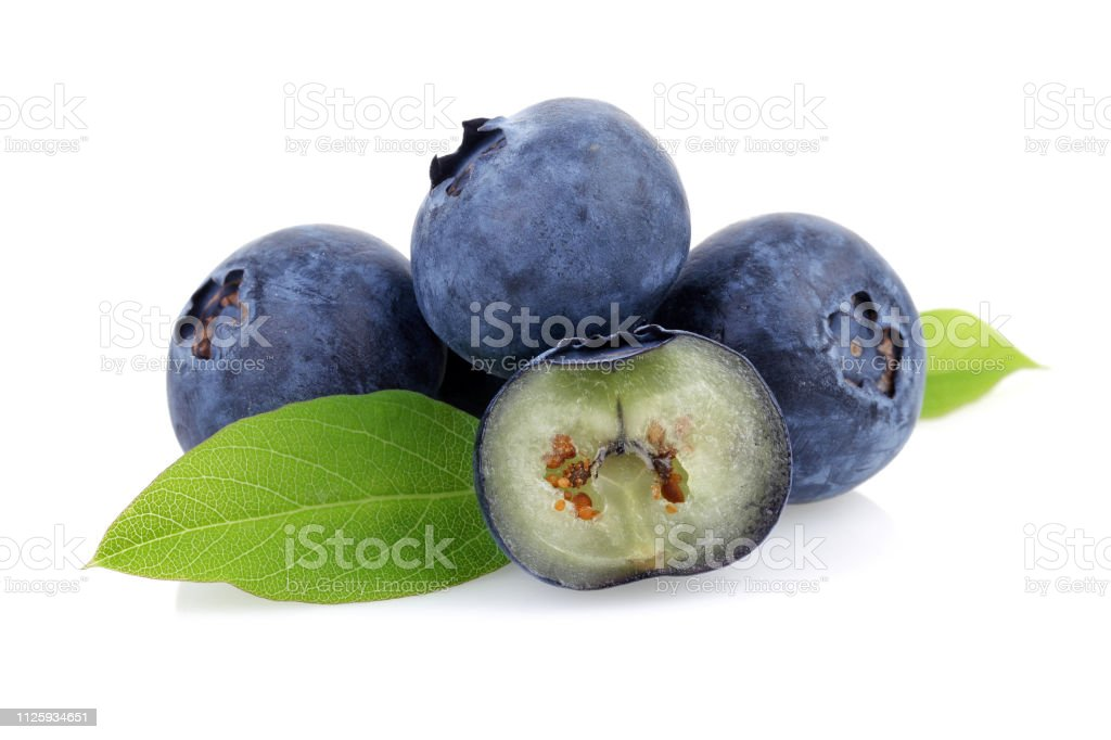 Fresh blueberries with leaves stock photo
