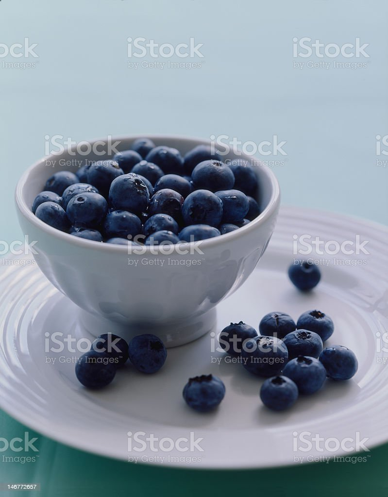 Fresh blueberry in bowl stock photo