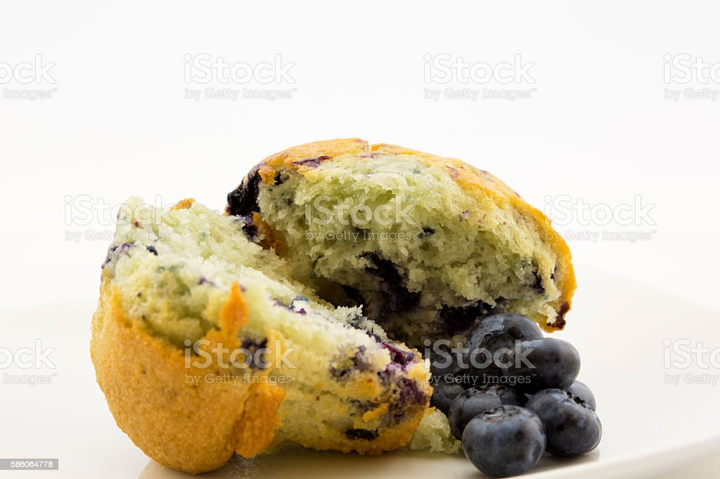 Fresh blueberry muffins and berries still life stock photo