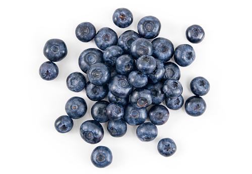 Pile of fresh blueberries over white background.
