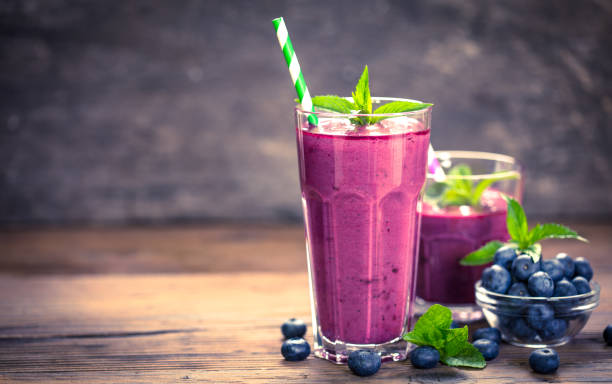 Fresh blueberry smoothie in the glass stock photo