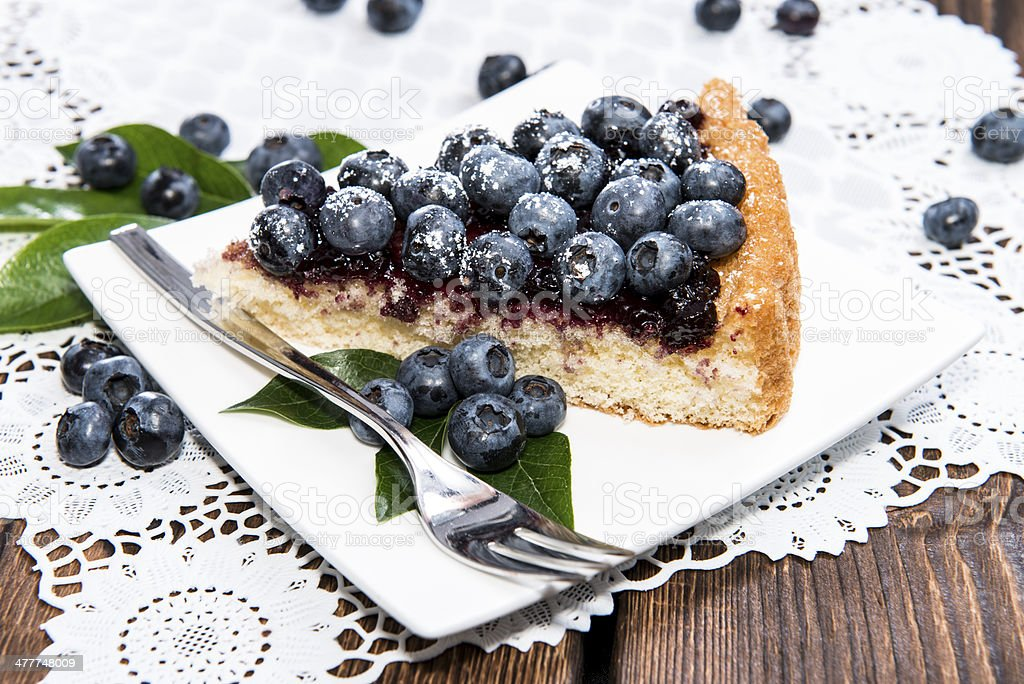 Fresh Blueberry Tart with fruits stock photo