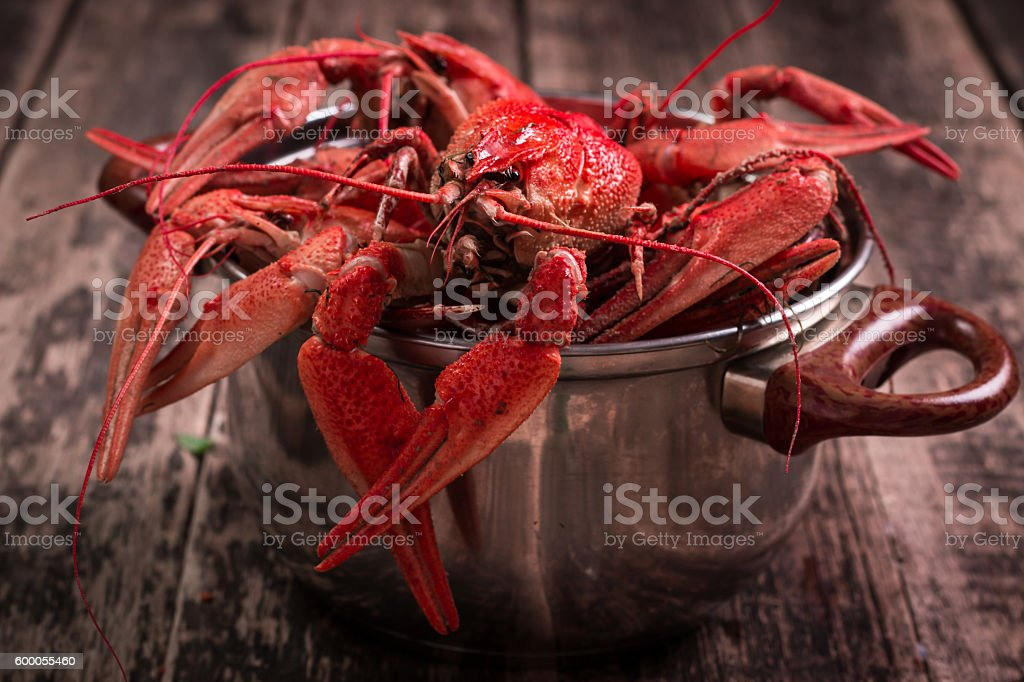 fresh boiled crawfish on the old wooden background stock photo