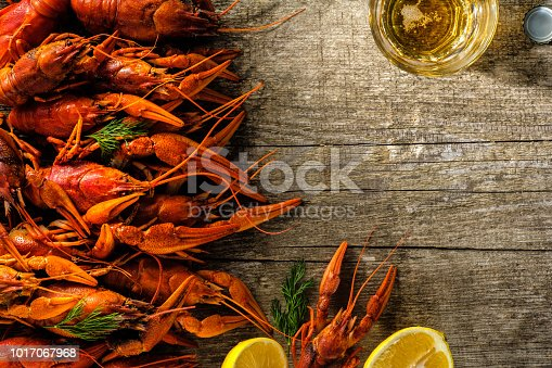 Fresh boiled crawfish with a mug of beer on a wooden table
