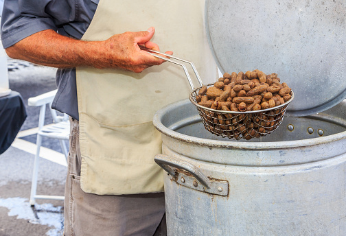 Fresh boiled peanuts being sold at a farmers market in Montgomery, Alabama.