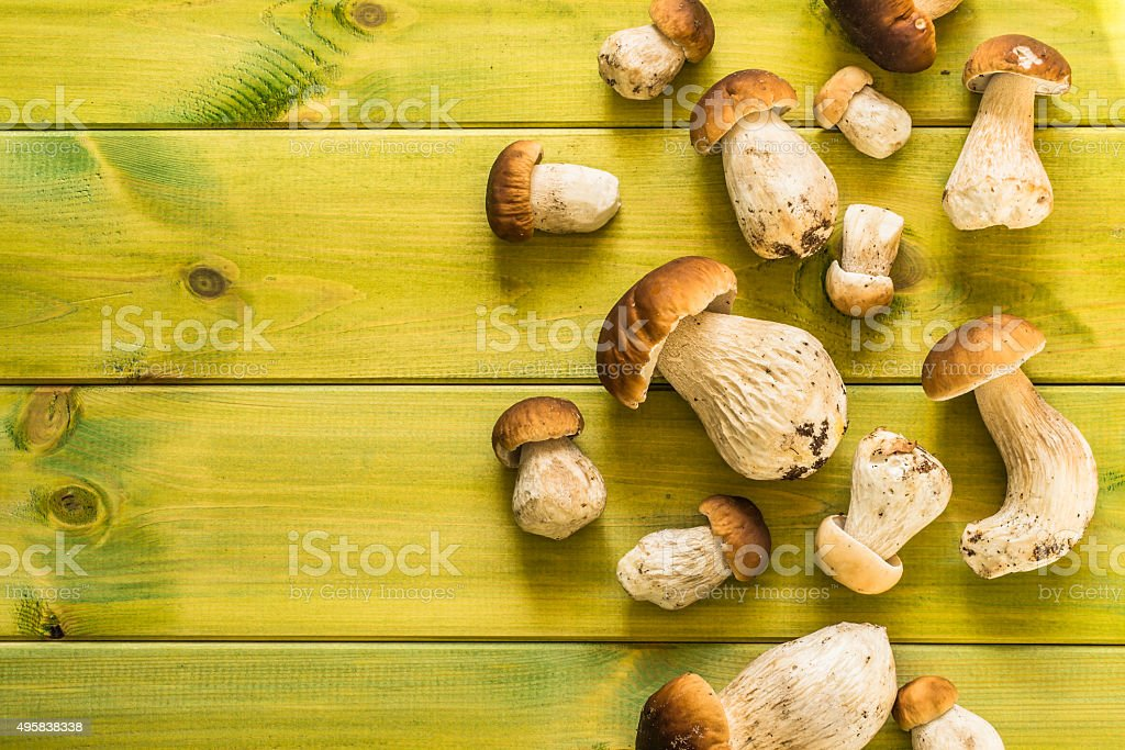 Fresh boletus mushrooms on wooden table. stock photo