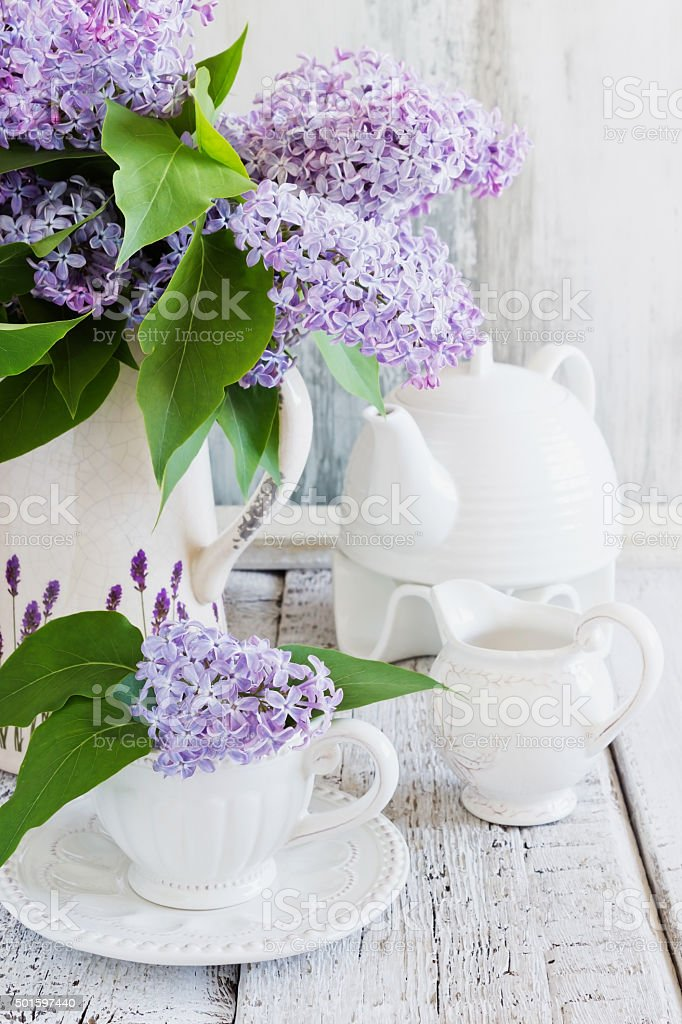 fresh bouquet of lilac fresh bouquet of lilac in the old vase on a wooden table. vintage toned. spring images 2015 Stock Photo