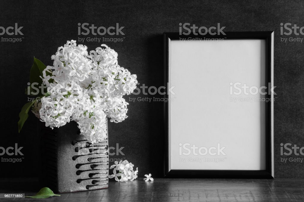 Fresh Bouquet Of White Lilac Flowers In The Black Vase On Dark