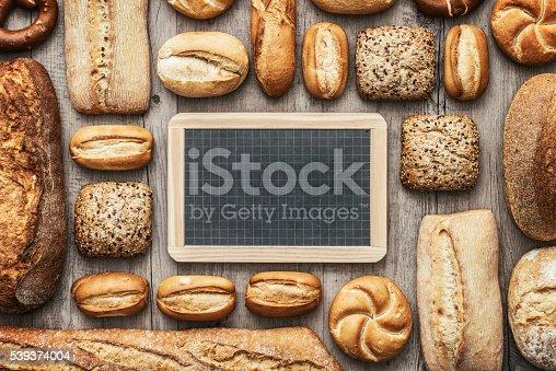 istock Fresh bread and chalkboard 539374004