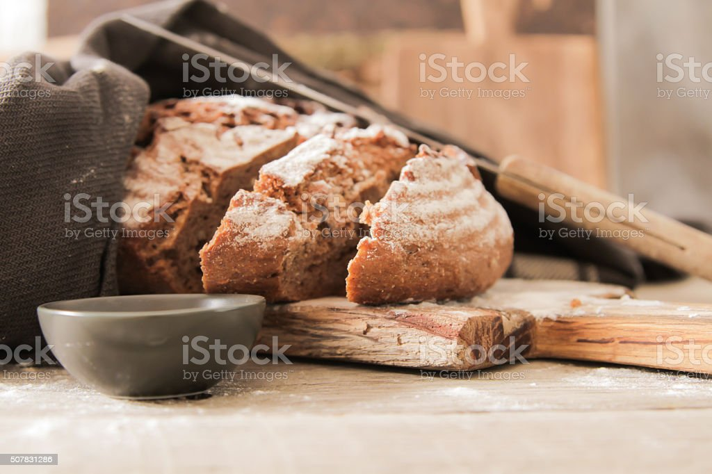 Fresh bread and salt on a wooden background stock photo