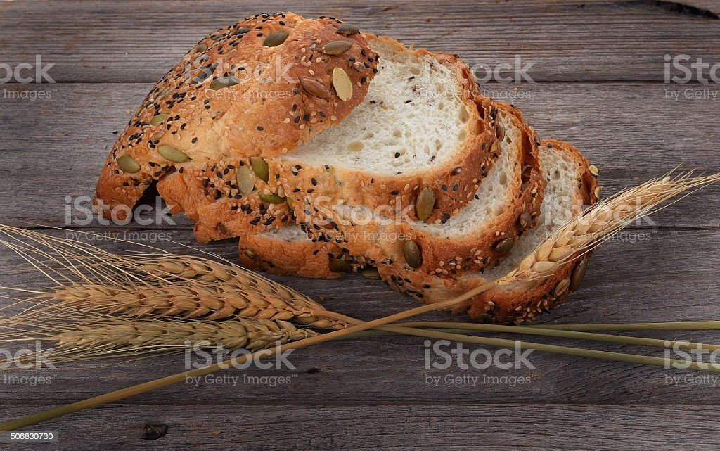 fresh bread and wheat on the wooden stock photo